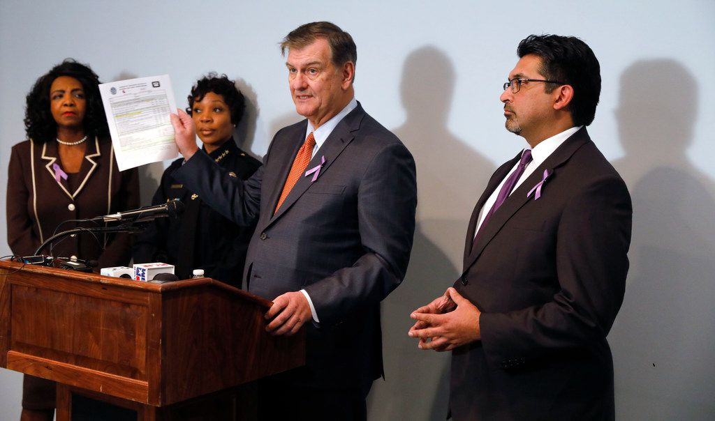 Dallas Mayor Mike Rawlings (third from left) holds a copy of the Domestic Violence Lethality Screen for First Responders doing a press conference with Dallas County District Attorney Faith Johnson, (from left) Dallas Police Chief U. Renee Hall and Judge Roberto Cañas Jr. of County Criminal Court #10 to discuss stronger enforcement of the gun surrender program, which takes guns from domestic abusers at the Genesis Women's Shelter in Dallas.