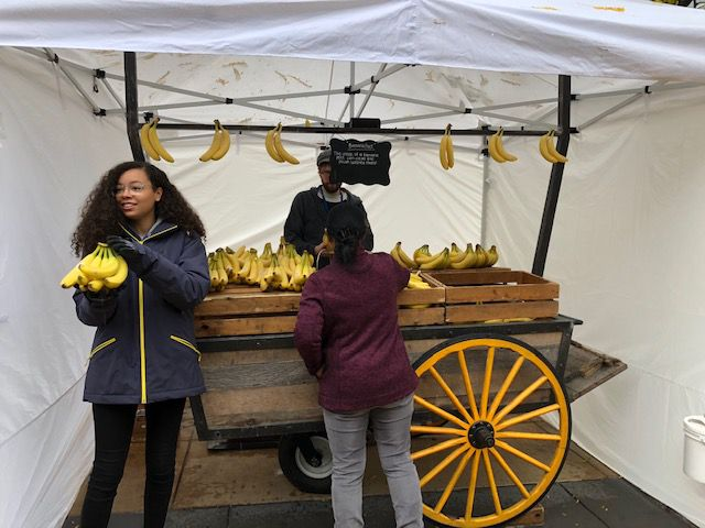 """Amazonians"" giving away free bananas from the daily banana stand."