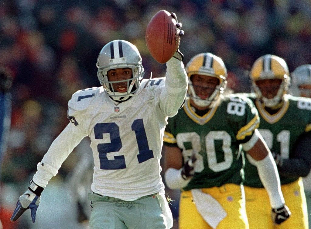 FILE - In this Nov. 23, 1997 file photo, Green Bay Packers Derrick Mayes (80) and Tyrone Davis (81) can't catch up as Dallas Cowboys' Deion Sanders returns an interception for a touchdown during the second quarter of an NFL football game in Green Bay, Wis. Sanders is a finalists for the Pro Football Hall of Fame which will be announced on Saturday, Feb. 5. (AP Photo/Dan Currier, File) ** NO SALES **