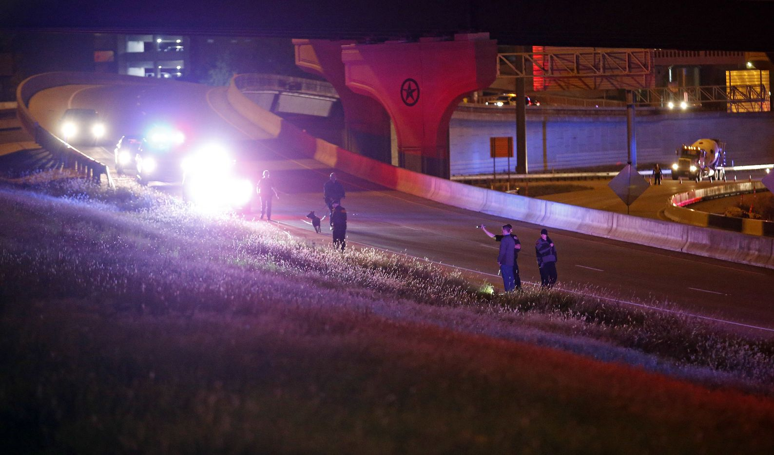 Police search for evidence near the Texas Tech Police Department on Monday night.