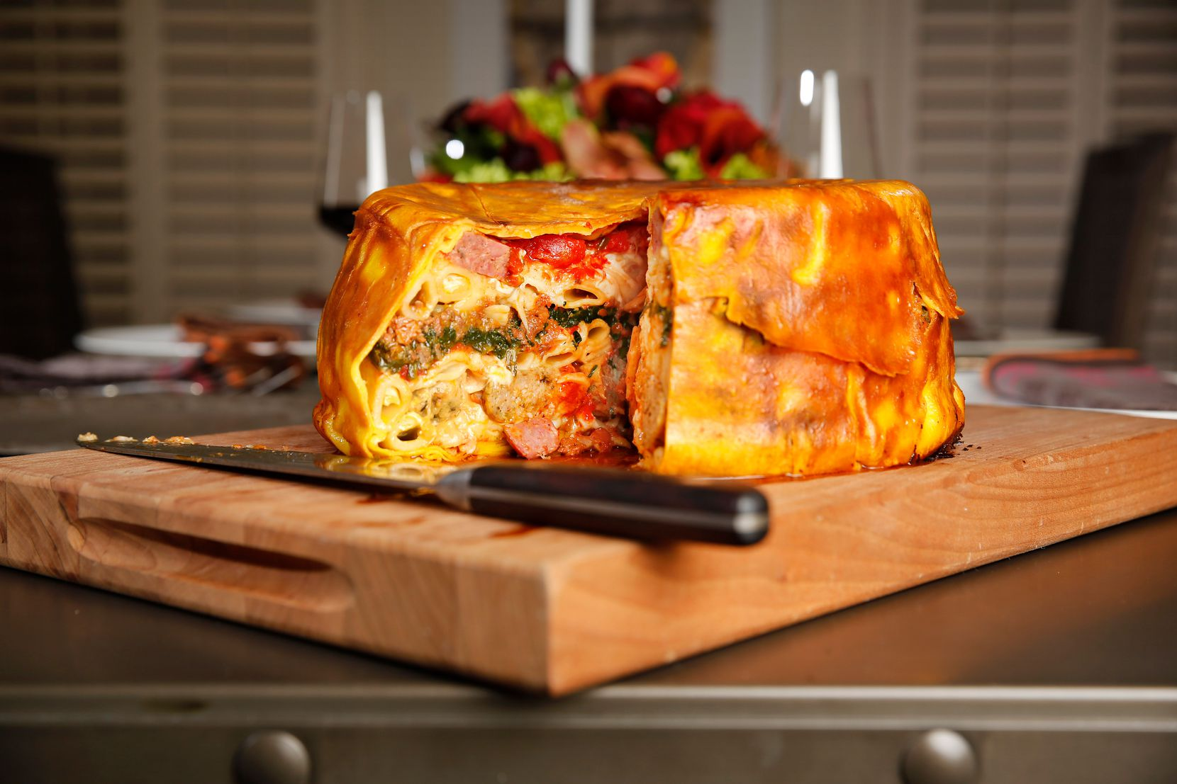 Chef Julian Barsotti's colossal, a 21-layer, two-day project,  contains all the flavors of an entire Italian restaurant. (Tom Fox/Staff Photographer)