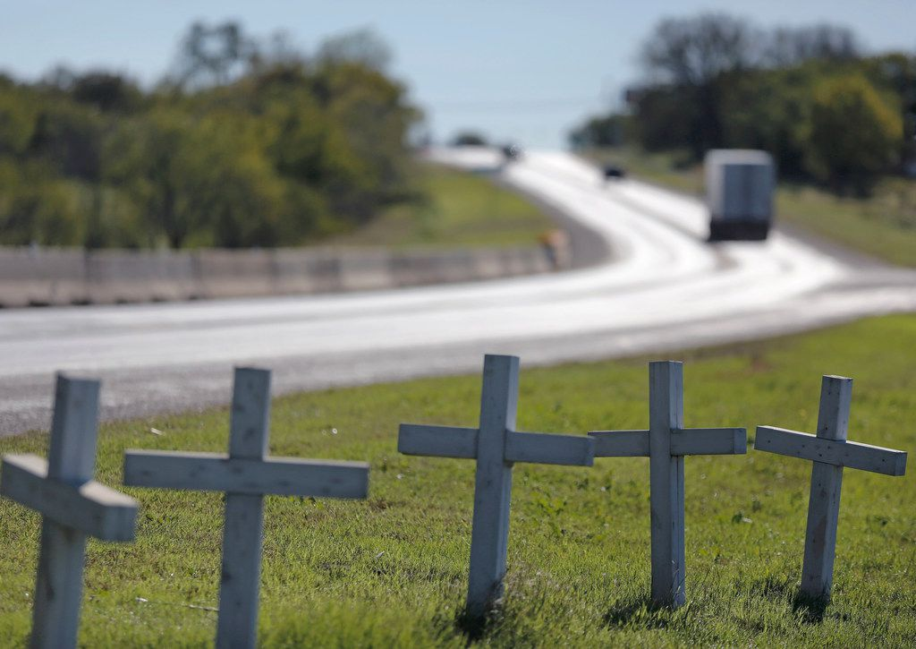 A row of crosses sit on the shoulder off of Highway 87 just north of the city limits in Sutherland Springs, Texas, photographed on Friday, November 2, 2018. November 5 is the one-year anniversary of the attack at Sutherland Springs Baptist Church, where 26 people were killed by a lone gunman at a Sunday morning worship service.
