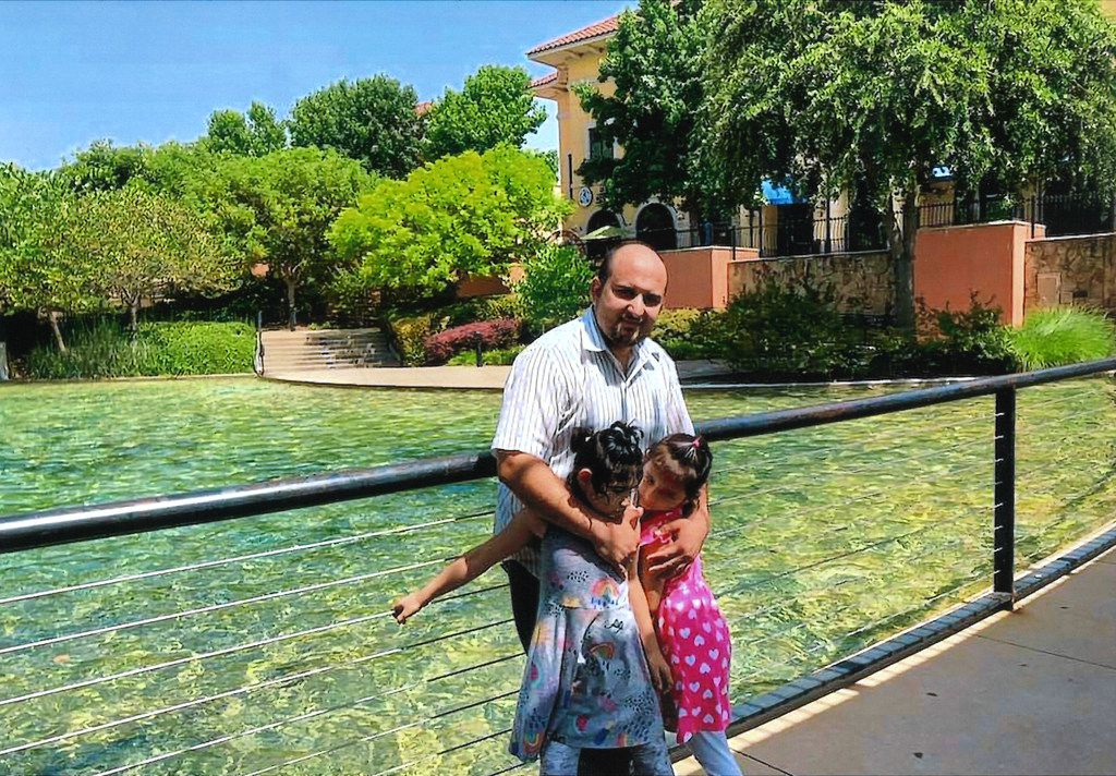 Mahir Ahmad Amiri with his two daughters, Nada and Zianib, at a park in Dalla months before the shooting.