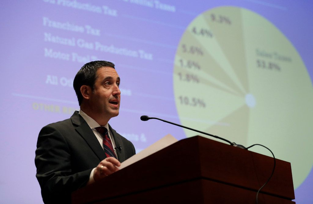 Comptroller Glenn Hegar, shown speaking to reporters and others interested in the state budget in January, says sales tax receipts will grow by 4.8% this year and 3.4% next year -- a far cry from fiscal 2012, when they grew by nearly 13%, or fiscal 2018, when they increased by 10.5%.