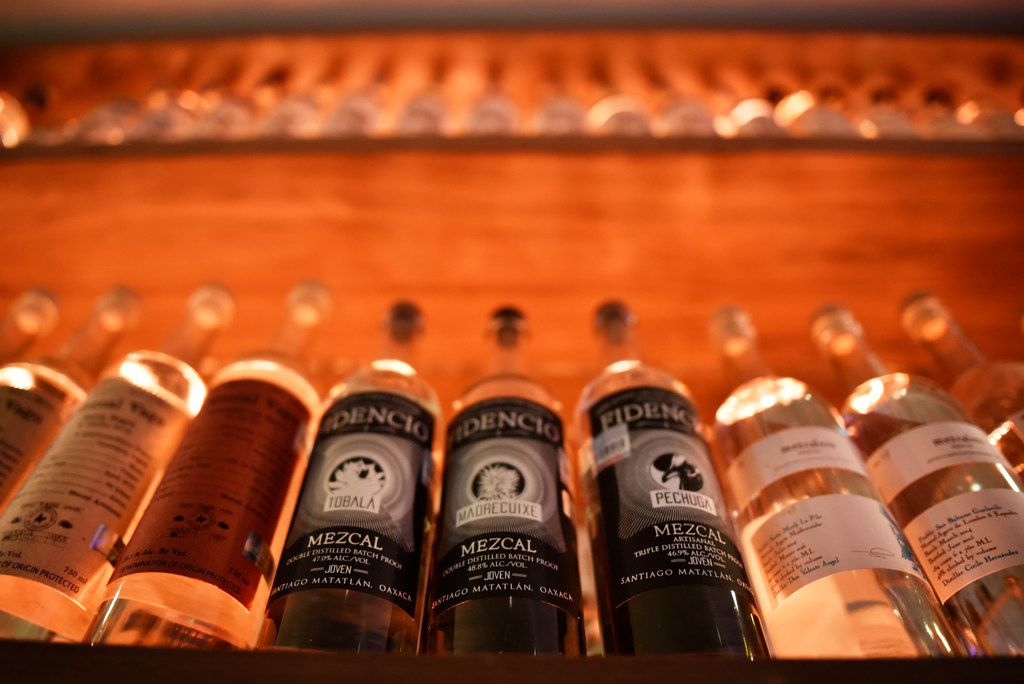 Different varieties of mezcal on display at La Viuda Negra, a new speakeasy-style bar in Dallas.