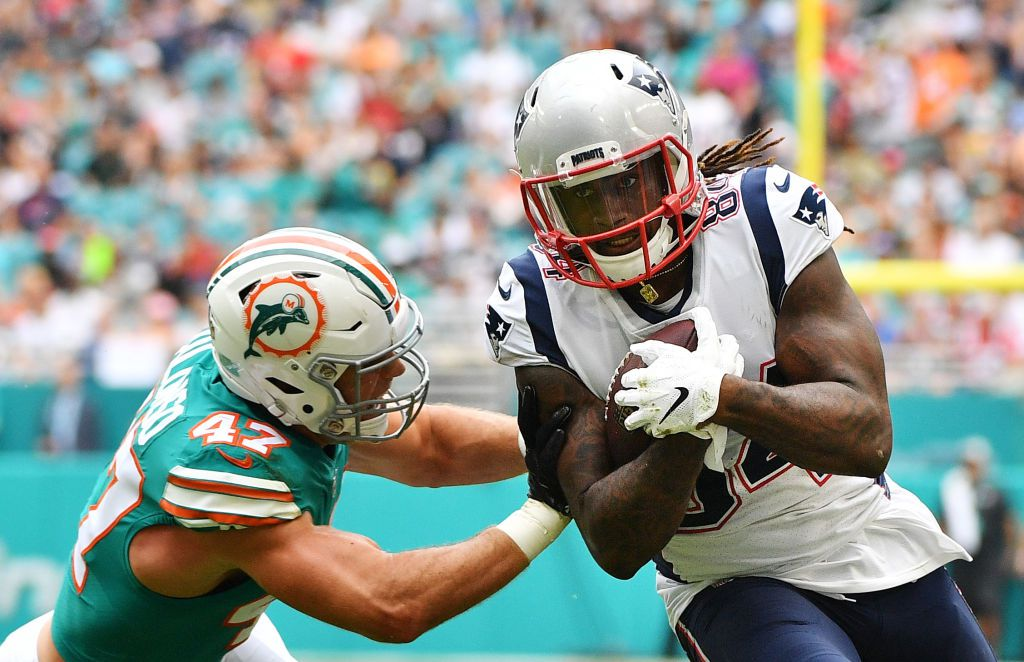 MIAMI, FL - DECEMBER 09:  Cordarrelle Patterson #84 of the New England Patriots tries to avoid the tackle of Kiko Alonso #47 of the Miami Dolphins in the first half at Hard Rock Stadium on December 9, 2018 in Miami, Florida.  (Photo by Mark Brown/Getty Images)