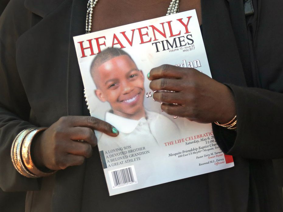 Mourners held the commemorative program as they emerged from the funeral service for Jordan Edwards. The funeral was May 6 at Mesquite Friendship Baptist Church.