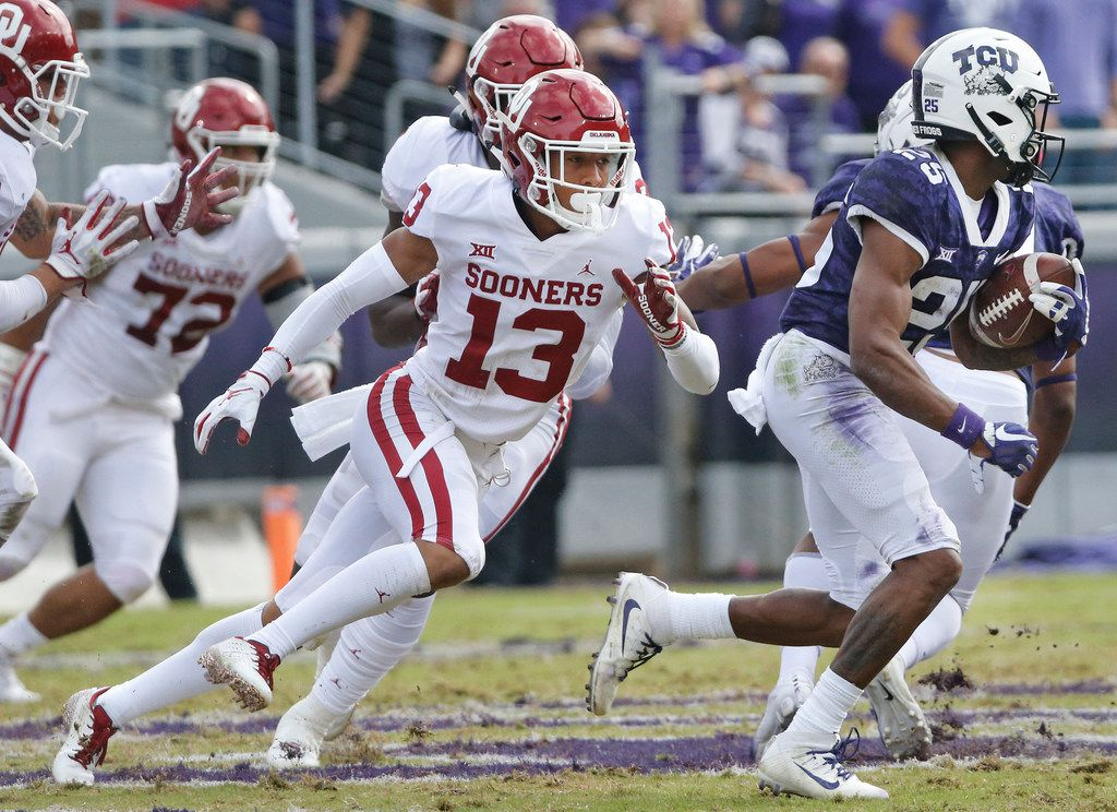 FILE - TCU wide receiver KaVontae Turpin (25) heads upfield for yardage after a catch as a host of Oklahoma defenders, including cornerback Tre Norwood (13), give chase during a game at Amon G. Carter Stadium in Fort Worth on Saturday, Oct. 20, 2018. (Louis DeLuca/The Dallas Morning News)