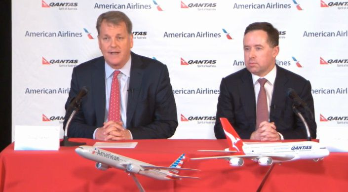 Doug Parker, left, speaks at Tuesday's press conference as Qantas CEO Alan Joyce awaits his turn.
