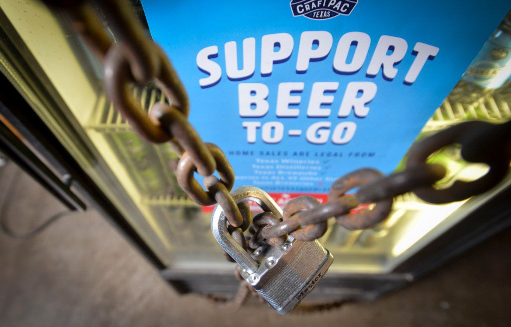 A chained and locked cooler of Oak Highlands Brewery's six packs awaits September 1 when brewers in Dallas, Texas will be able to sell the six packs to customers.