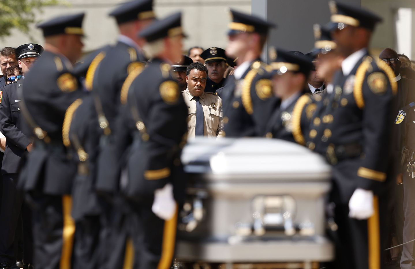 Arlington Honor Guard finish up folding the flag as officers watch during a memorial service for DART Officer Brent Thompson at The Potter's House in Dallas on Wednesday, July 13, 2016. Thompson was one of five officers killed last week when a gunman opened fire during a Black Lives Matter rally in downtown Dallas.