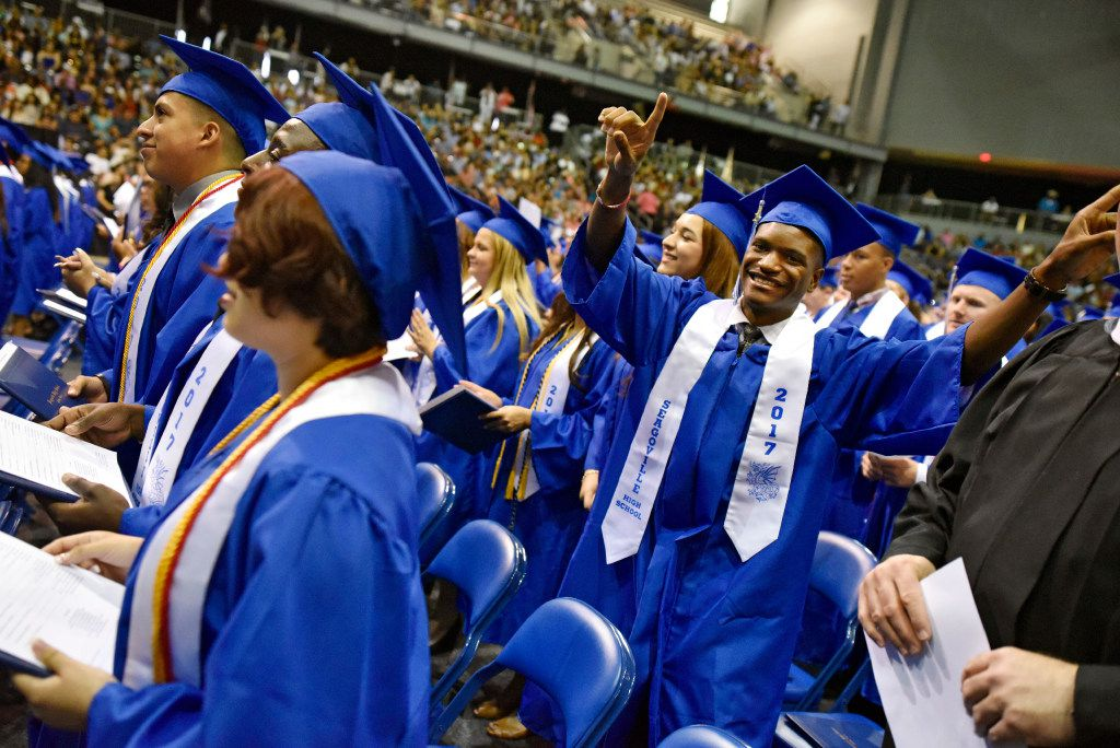 Isaiah Cherry dances as the a graduation ceremony comes to an end for Seagoville High School at the Ellis Davis Field House in Dallas, Sunday, May 28, 2017. Ben Torres/Special Contributor