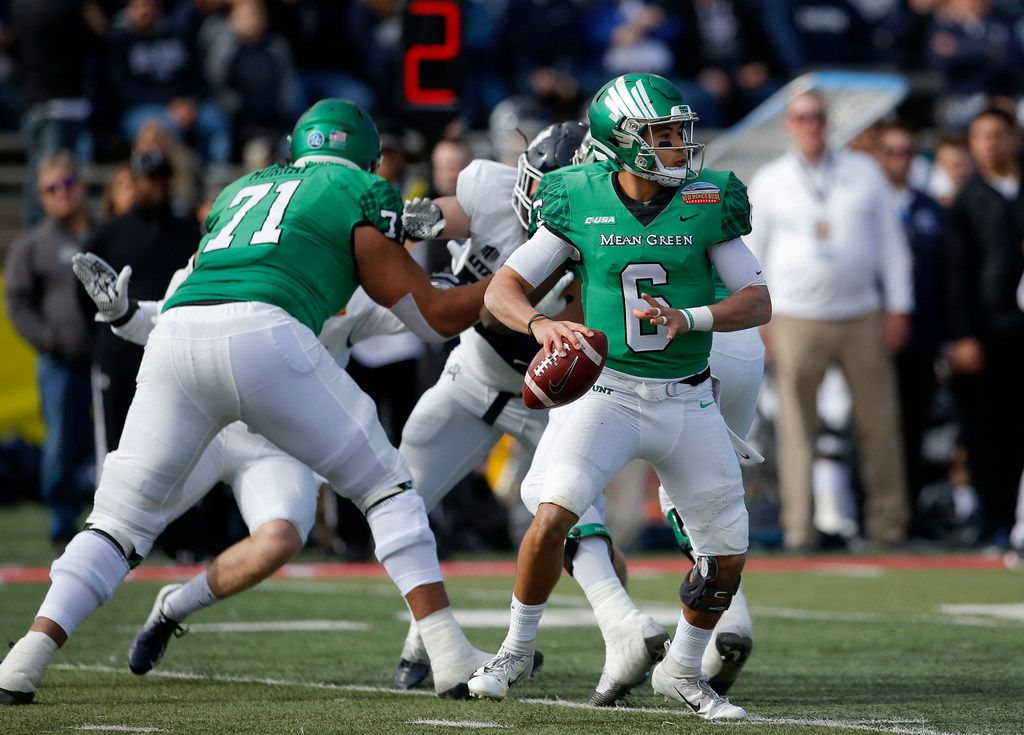 North Texas quarterback Mason Fine (6) looks to throw a pass during the first half of the New Mexico Bowl NCAA college football game against Utah State in Albuquerque, N.M., Saturday, Dec. 15, 2018. (AP Photo/Andres Leighton) ORG XMIT: OTKAL102