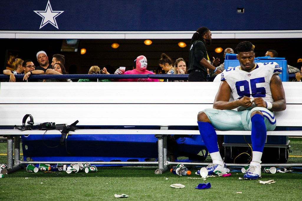 Dallas Cowboys defensive tackle David Irving sits on the bench following the Cowboys' 35-31 loss to the Green Bay Packers in an NFL football game at AT&T Stadium on Sunday, Oct. 8, 2017, in Arlington, Texas. Irving sacked Packers QB Aaron Rodgers twice in the game, but Rodgers broke an attempted tackle by Irving for an 18-yard run with 29 seconds left in the game, setting up the winning touchdown two plays later. (Smiley N. Pool/The Dallas Morning News)