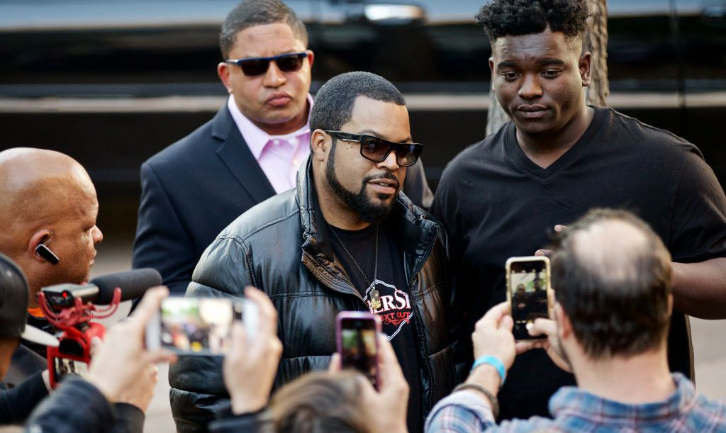 """O'Shea Jackson, known by his stage name Ice Cube, poses for photographs with fans before a screening of """"Barbershop, The Next Cut"""" at the Angelika Monday, March 21, 2016. (Brandon Wade/Special Contributor)"""