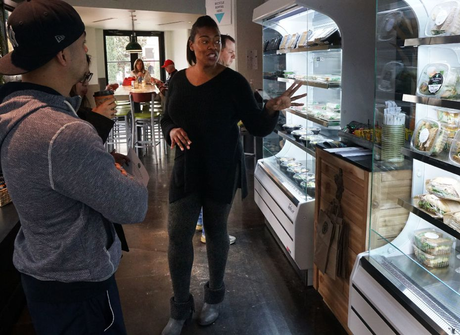 Chef Tiffany Derry speaks with customers at Uptown Urban Market in Dallas, Texas on Friday, December 10, 2016. (Lawrence Jenkins/Special Contributor)