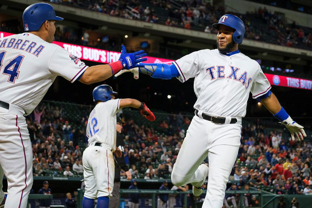 Texas Rangers shortstop Elvis Andrus celebrates with third baseman Asdrubal Cabrera after scoring on a single by Joey Gallo during the seventh inning against the Houston Astros at Globe Life Park on Tuesday, April 2, 2019, in Arlington. (Smiley N. Pool/The Dallas Morning News)