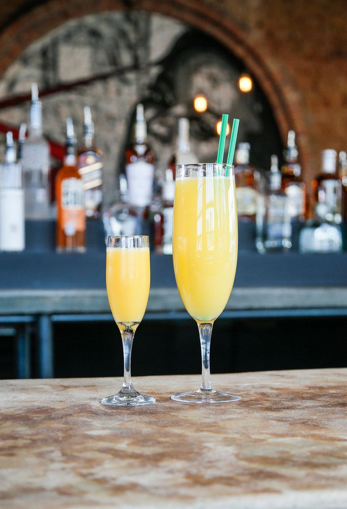 """That's the """"Giant Flute of Mimosa,"""" on the right. It holds a whole bottle of Champagne. That's a regular Champagne flute, dwarfed on the left."""