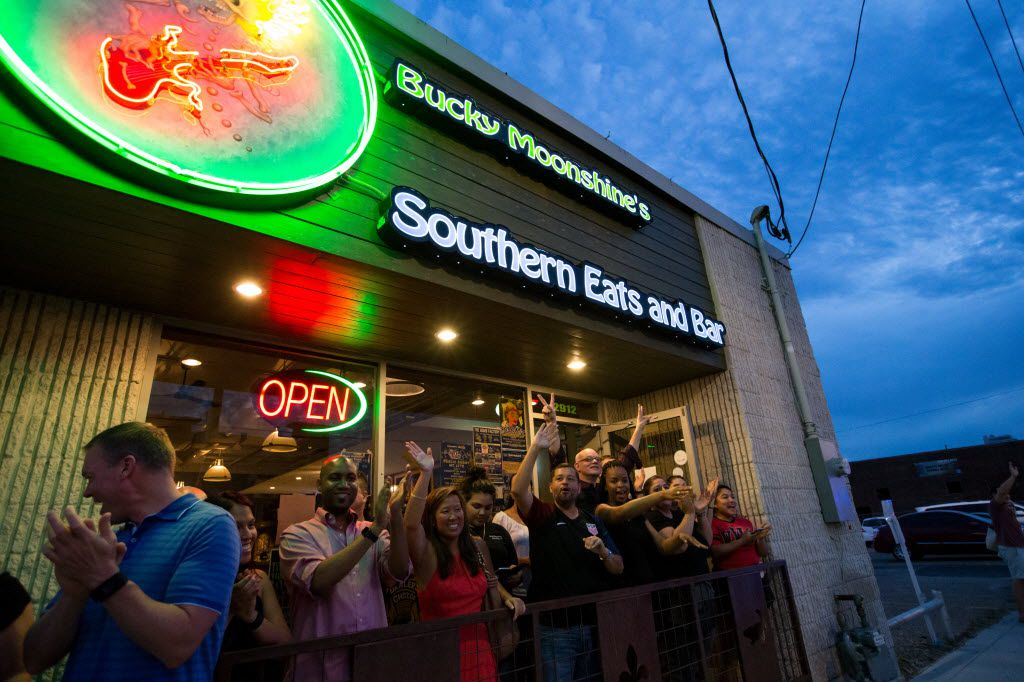 Patrons of Bucky Moonshine's Southern Eats and Bar cheer on during the Queer Bomb Dallas procession march though in Deep Ellum streets on June 25, 2016 in Dallas. (Ting Shen/The Dallas Morning News)