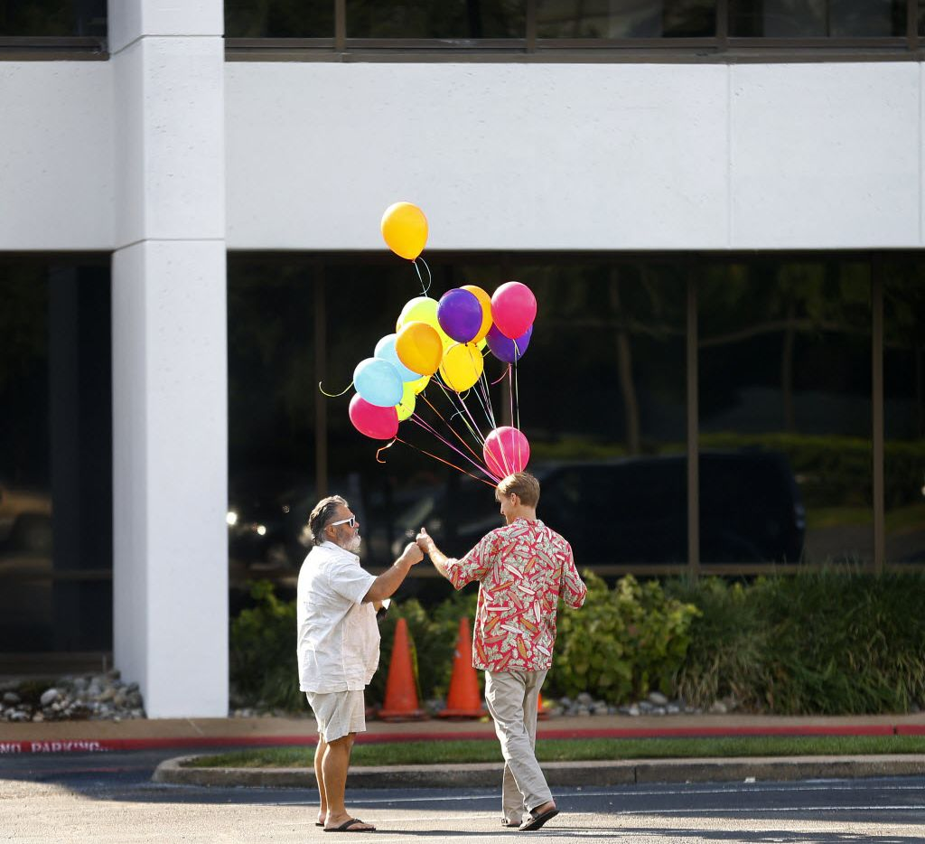 Top 100  Publishing Concepts LP Inside Sales Representative Darrell Toups (left) receives a fist bump from CEO Drew Clancy following their Santa Barbara Beach Party where Clancy handed out awards to employees and where they won gifts and prizes during a drawing at their Dallas offices, Friday, September 25, 2015.  (Tom Fox/The Dallas Morning News)