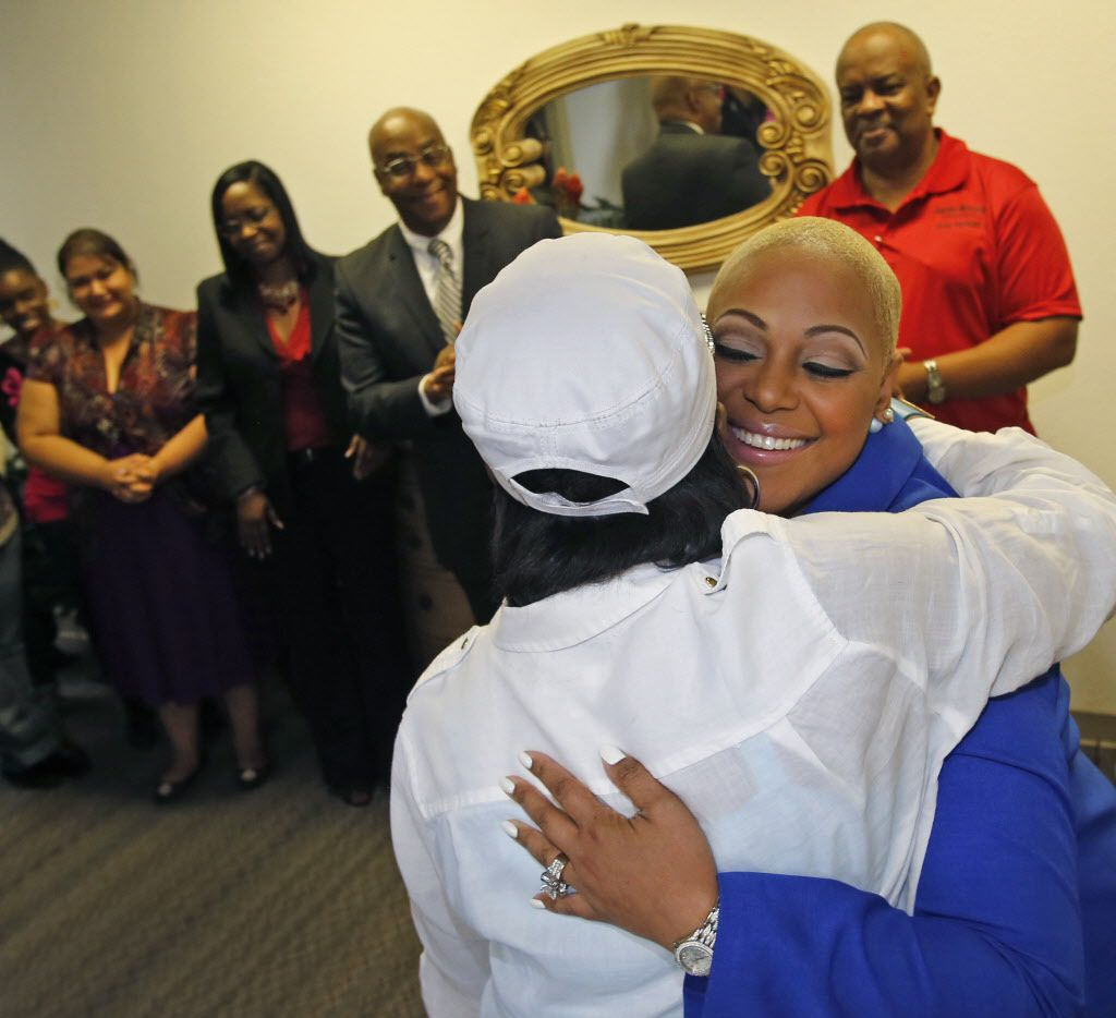 Prosper businesswoman Anita Hawkins, right, of the One Reason to Smile organization, hugs Debra Nixon Bowles of the Women Called Moses Outreach Center, after donating a check for almost $15,000 to the organization, which assists victims of domestic abuse, photographed on Thursday, April 23, 2015.