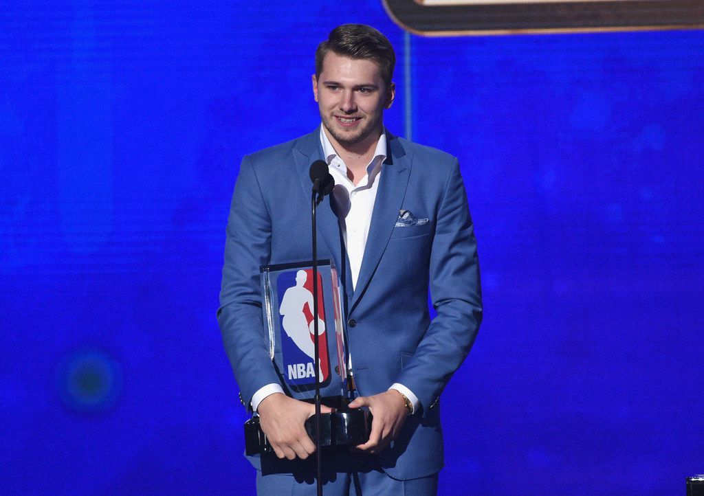 Luka Doncic, of the Dallas Mavericks, accepts the NBA rookie of the year award at the NBA Awards on Monday, June 24, 2019, at the Barker Hangar in Santa Monica, Calif. (Photo by Chris Pizzello/Invision/AP)