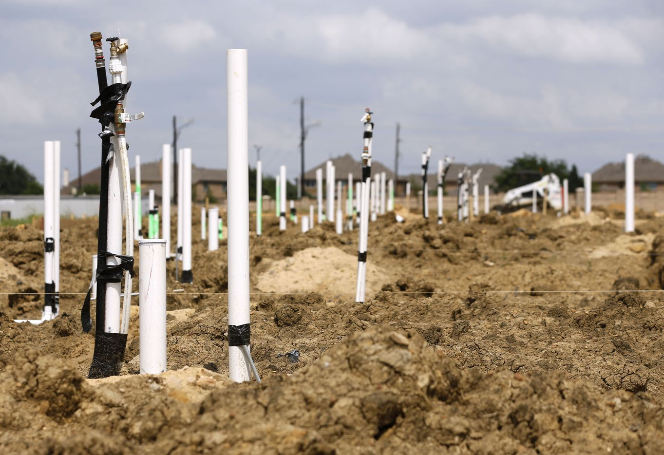 Townhomes under construction in Little Elm, Texas on Wednesday, May 22, 2019. Little Elm, which had just 3,500 people as of the 2000 Census, surpassed 50,000 residents in 2018. (Vernon Bryant/The Dallas Morning News)