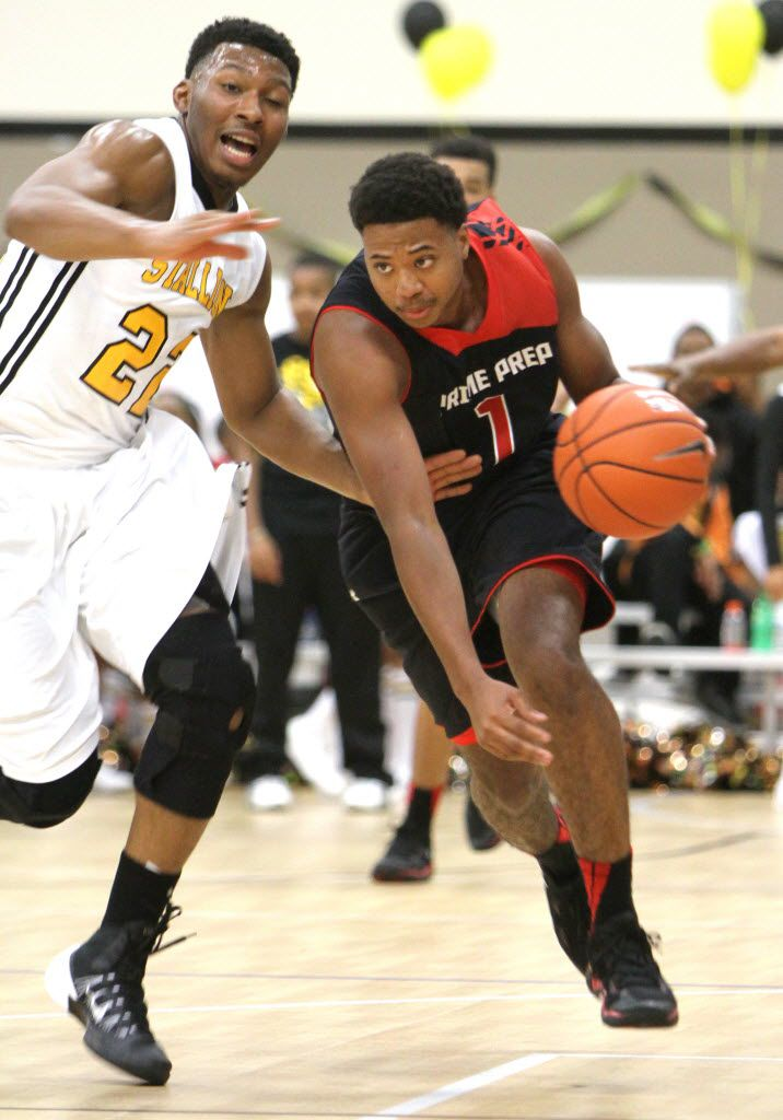 Prime Prep's Devonte' Bailey (1) drives past the defense of Triple A Academy's King McClure (22) in November 2013. (Steve Hamm/Special Contributor)