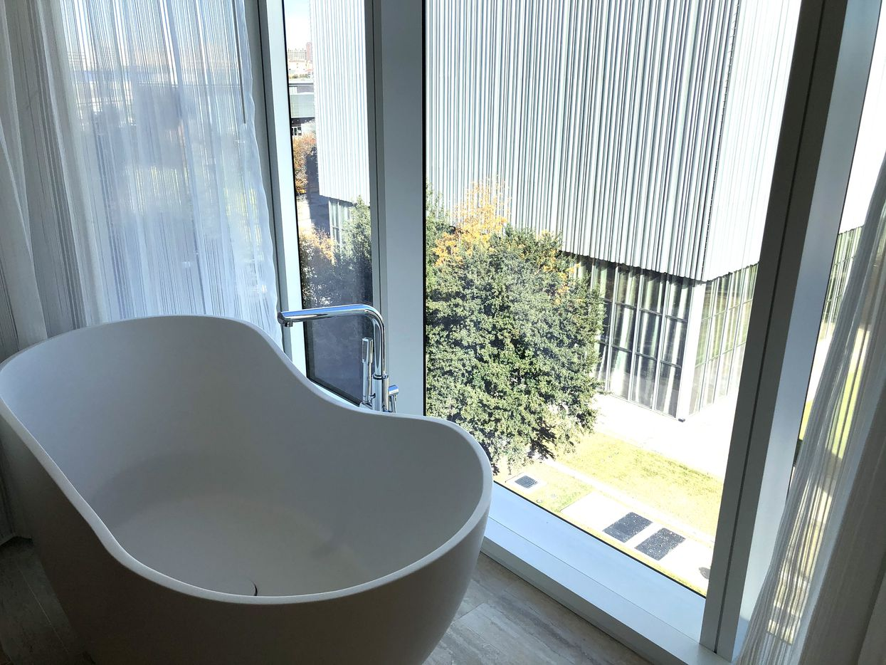 The bathtub in the room has a view of the Arts District.