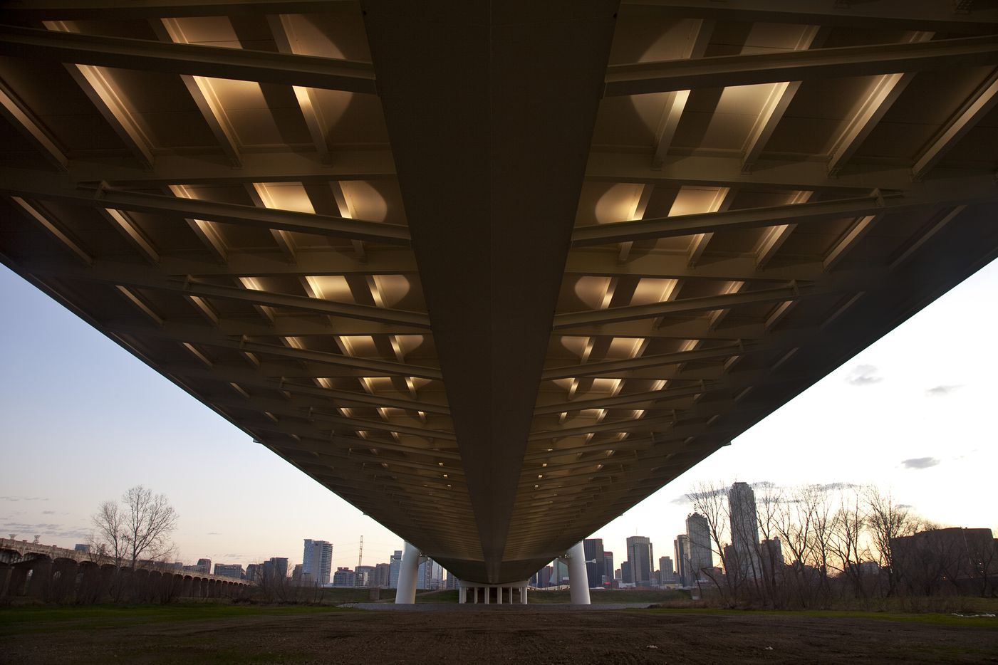 Lights highlight the underside of the Margaret Hunt Hill Bridge roadway decking on January 17, 2012, as seen inside from inside the levees west of the Trinity River channel.  World-renowned architect Santiago Calatrava designed the bridge. (Tom Fox/The Dallas Morning News)