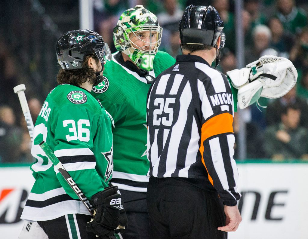 Dallas Stars center Mats Zuccarello (36) and goaltender Ben Bishop (30) dispute a call with referee Marc Joannette (25) during the second period of Game 6 of the first round of Stanley Cup Playoffs between the Dallas Stars and the Nashville Predators on Monday, April 22, 2019 at American Airlines Center in Dallas. (Ashley Landis/The Dallas Morning News)