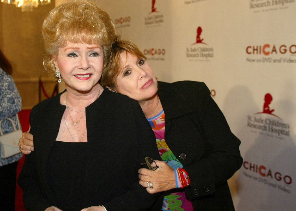 """In this Tuesday, Aug. 19, 2003 file photo, Debbie Reynolds and Carrie Fisher arrive at the """"Runway for Life"""" Celebrity Fashion Show Benefitting St. Jude's Children's Research Hospital and celebrating the DVD relese of Chicago in Beverly Hills, Calif. On Tuesday, Dec. 27, 2016, a publicist said Fisher has died at the age of 60."""