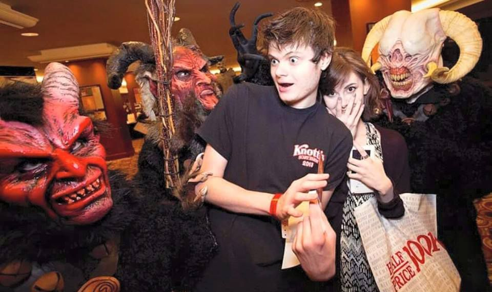 Jack McClurg, center, documents his experiences at haunted houses and, with the help of his father Keny, posts video critiques to his YouTube channel, Jack's Haunts.