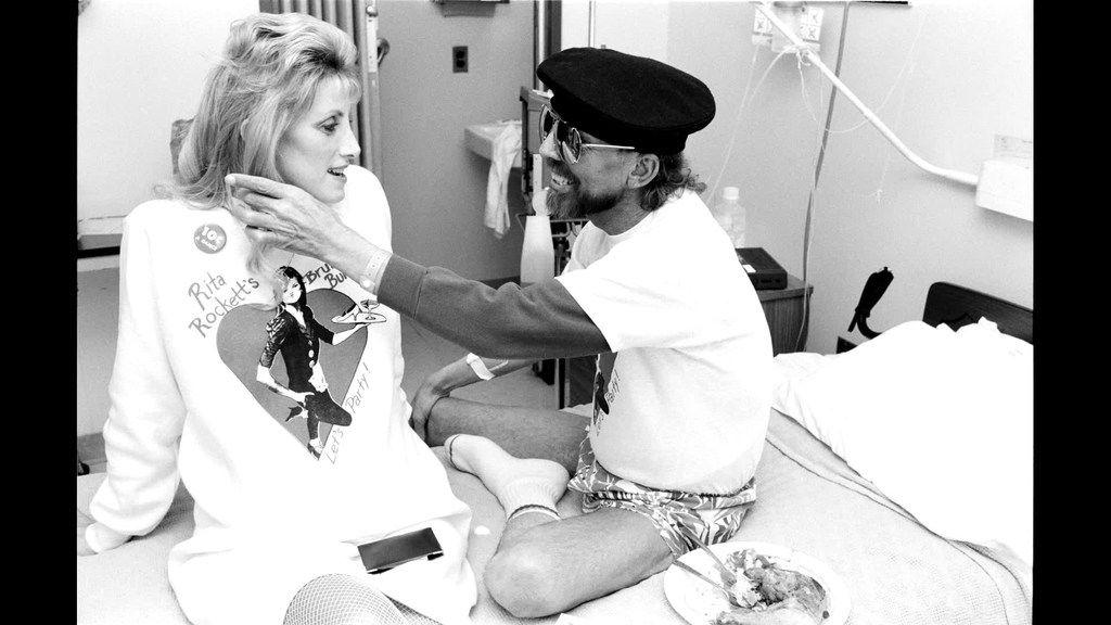 Ward 5B caregiver Rita Rockett visits with a patient