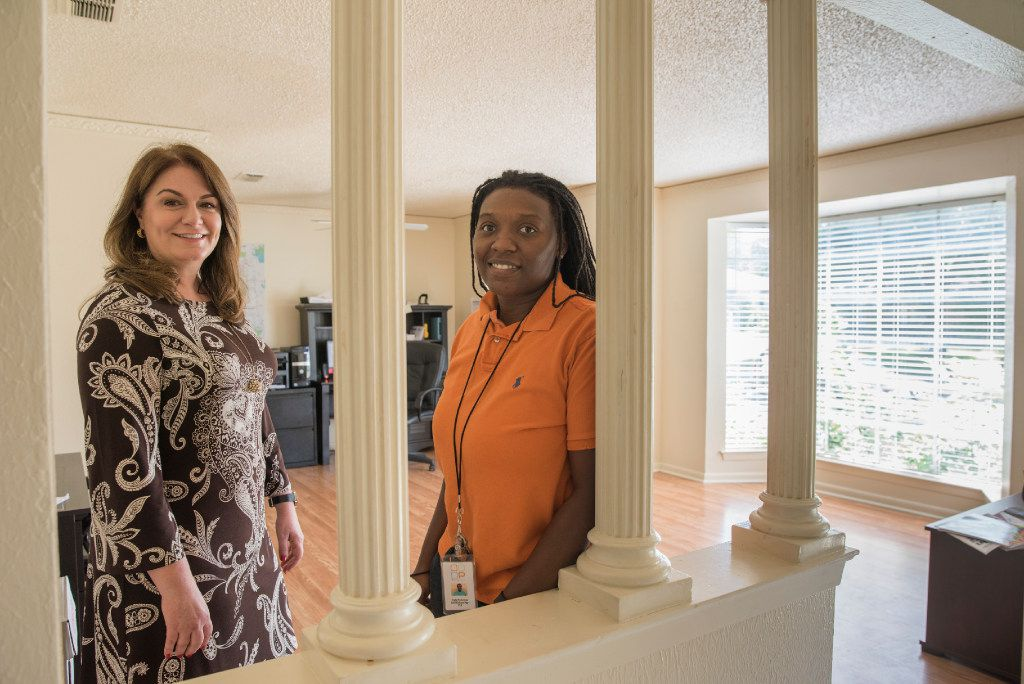 Ashley Lind (left), CEO of Promise House, and case manager Liz McGowan stand in the office  of the shelter in southern Dallas.