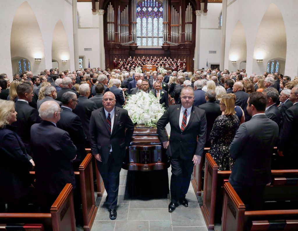 Pallbearers walk the casket bearing T. Boone Pickens out of Highland Park United Methodist Church.