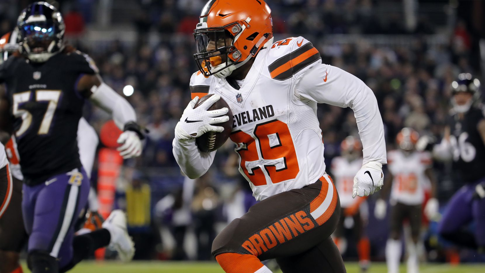 FILE - Cleveland Browns running back Duke Johnson rushes the ball in the second half of an NFL football game against the Baltimore Ravens, Sunday, Dec. 30, 2018, in Baltimore. (AP Photo/Carolyn Kaster)