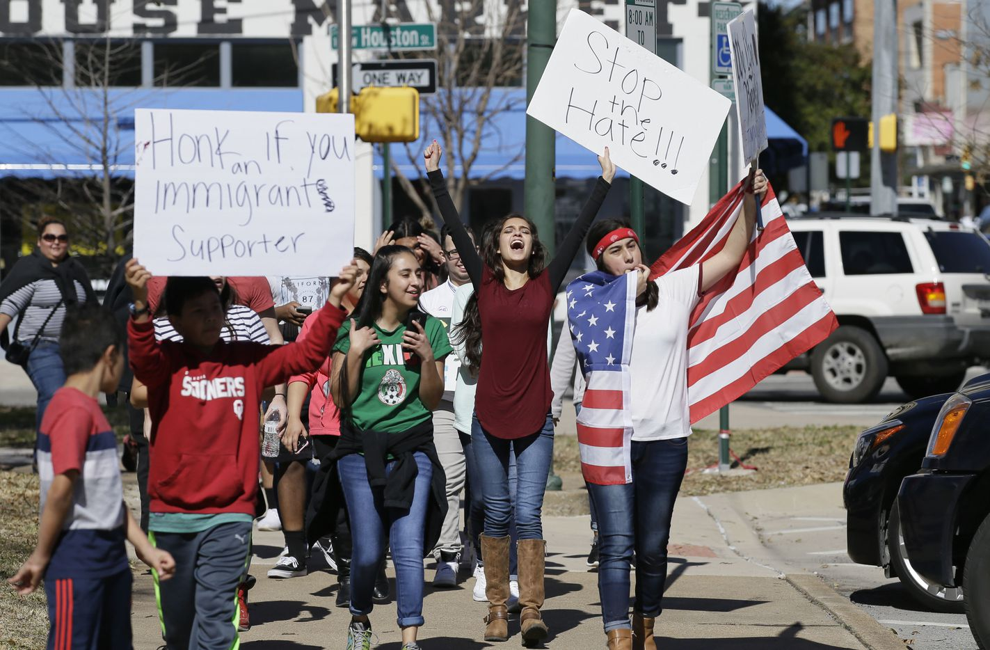 "Immigrant supporters marches with others during a protest outside the Grayson County courthouse in downtown Sherman, Texas, Thursday, Feb. 16, 2017. In an action called ""A Day Without Immigrants,"" immigrants across the country are expected to stay home from school, work and close businesses to show how critical they are to the U.S. economy and way of life."