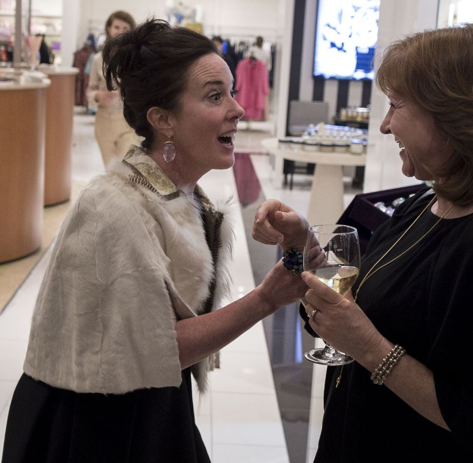 Kate Spade reacts as she meets Kathy Rohr, a classmate and friend from St. Teresa's Academy, during an event at Hall's on Grand at Crown Center Plaza in 2016.