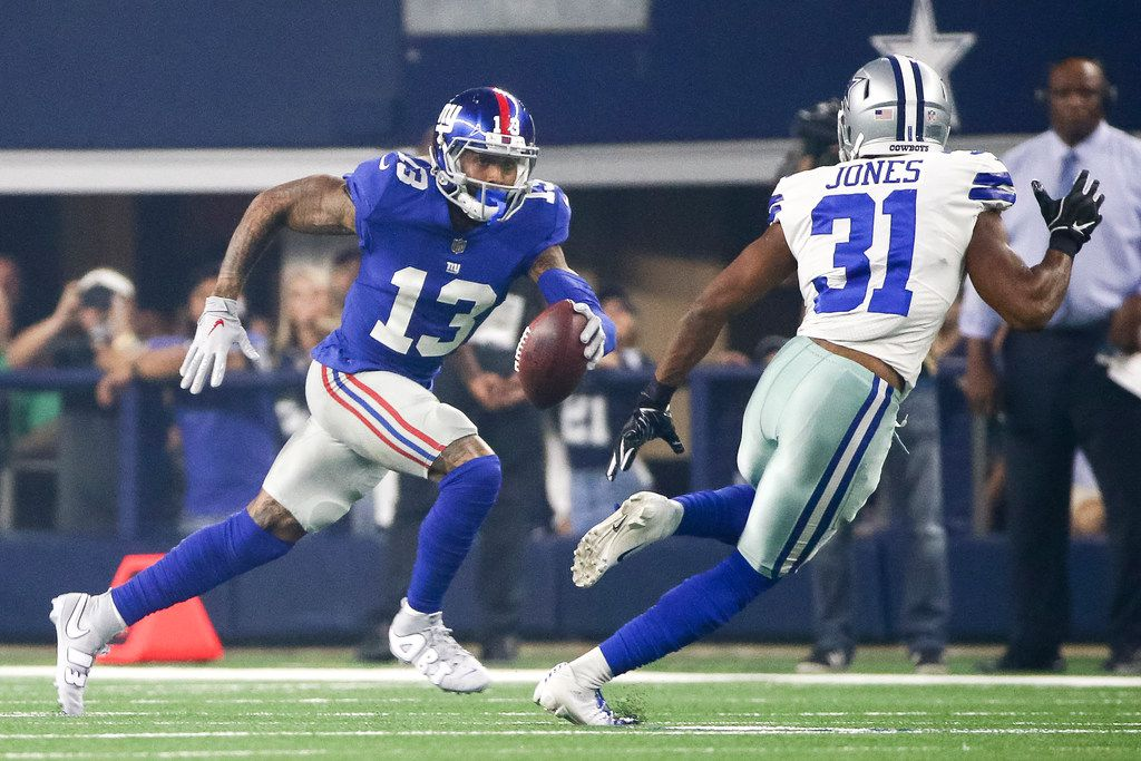 New York Giants wide receiver Odell Beckham (13) carries the ball as he is defended by New York Giants defensive back Michael Thomas (31) during an NFL game between the Dallas Cowboys and New York Giants on Sunday, September 16, 2018 at AT&T Stadium in Arlington, Texas. (Shaban Athuman/ The Dallas Morning News)