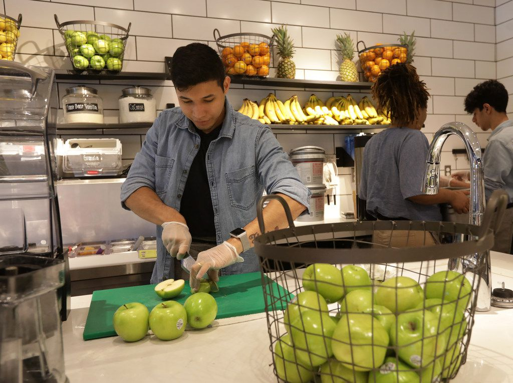 Jonathan Olivera cuts some apples at Original Chop Shop in Plano, TX, on Jun. 13, 2019. (Jason Janik/Special Contributor)
