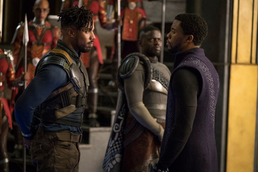 "Eric ""Killmonger"" Stevens (Michael B. Jordan, left) is brought to the throne room to confront King T'Challa (Chadwick Boseman) in ""Black Panther"" as W'Kabi (Daniel Kaluuya, background)  waits."
