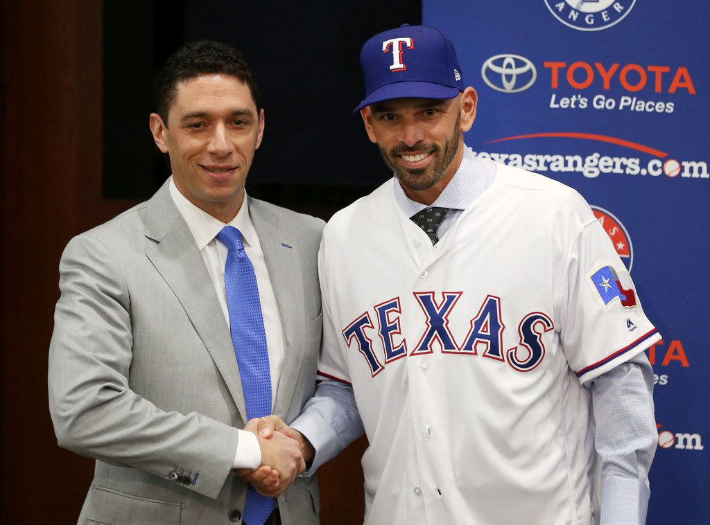Texas Rangers' new manager Chris Woodward shakes hands with General Manager Jon Daniels (left) during a press conference announcing his position at Globe Life Park in Arlington, Texas on Monday, Nov. 5, 2018. (Rose Baca/The Dallas Morning News)