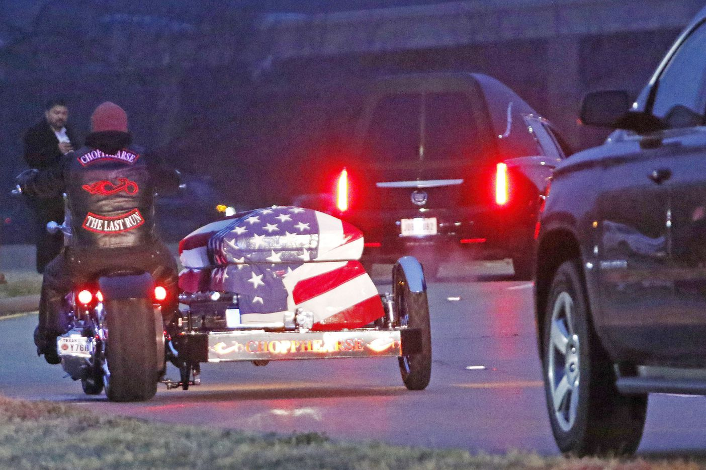 A motorcycle carrying Richardson police officer David Sherrard leads funeral procession at Watermark Community Church in Dallas, Texas, Tuesday, February 13, 2018.