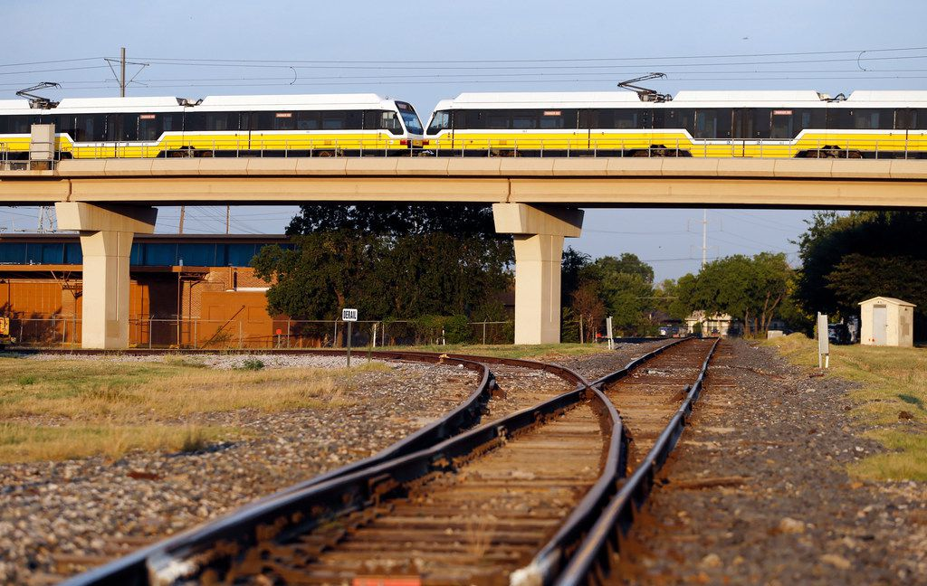 A DART Red Line train passes over a set of tracks near 12th Street and Avenue K in Plano. The site is the planned location of the 12th Street DART Station and a place where the east-west Cotton Belt commuter rail will align with north-south light rail.