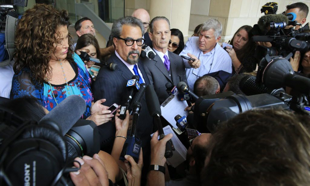 Special prosecutors Kent Schaffer, left, and Brian Wice respond to questions from the news media after Texas Attorney General Ken Paxton left the Tim Curry Criminal Justice Center in Fort Worth on Aug. 27, 2015. The prosecutors are now locked in a fight over whether their pay scale violates local rules and state law.