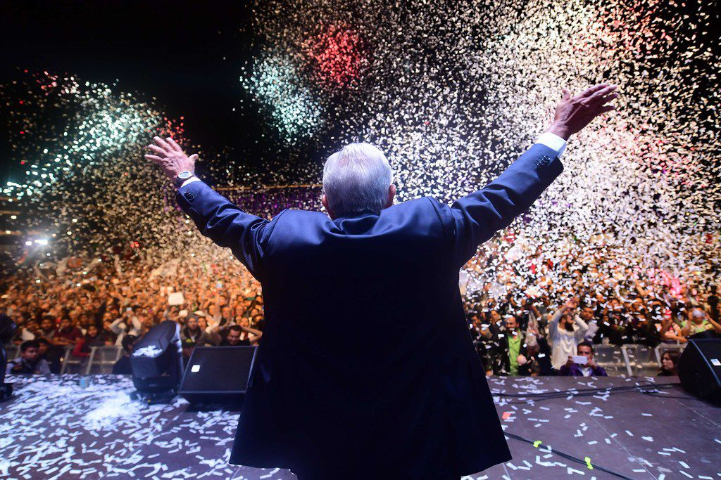 Newly elected Mexican President Andres Manuel Lopez Obrador cheers his supporters at the Zocalo Square in Mexico City after winning general elections on July 1, 2018.