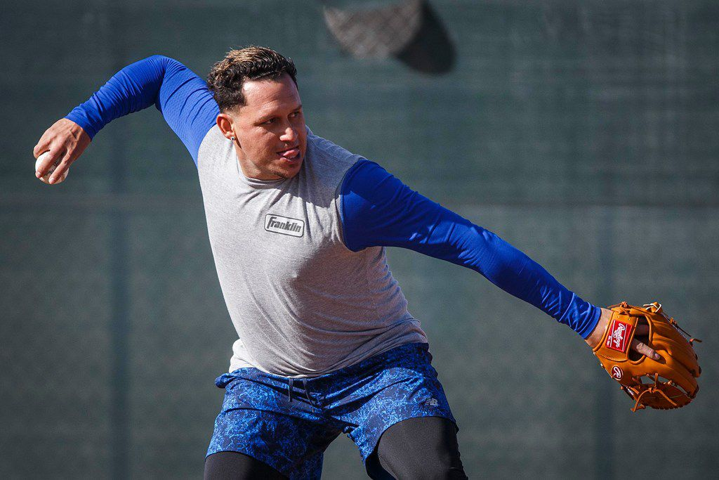 Texas Rangers infielder Asdrubal Cabrera takes infield practice during a spring training workout at the team's training facility on Saturday, Feb. 16, 2019, in Surprise, Ariz.. (Smiley N. Pool/The Dallas Morning News)