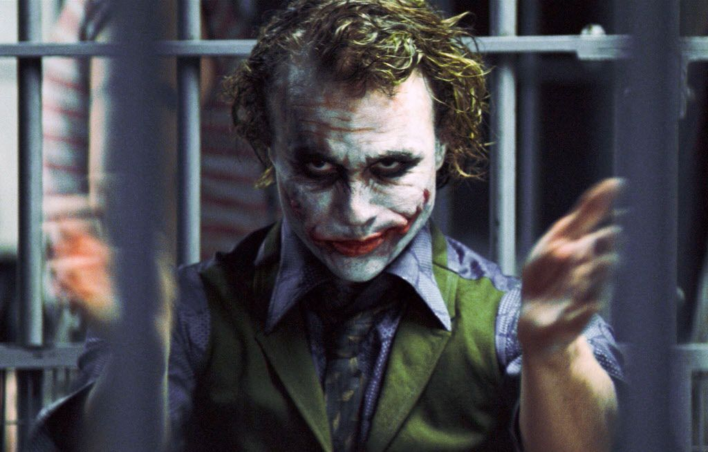 """In this undated image originally released by Warner Bros., Heath Ledger portrays The Joker in a scene from """"The Dark Knight."""""""