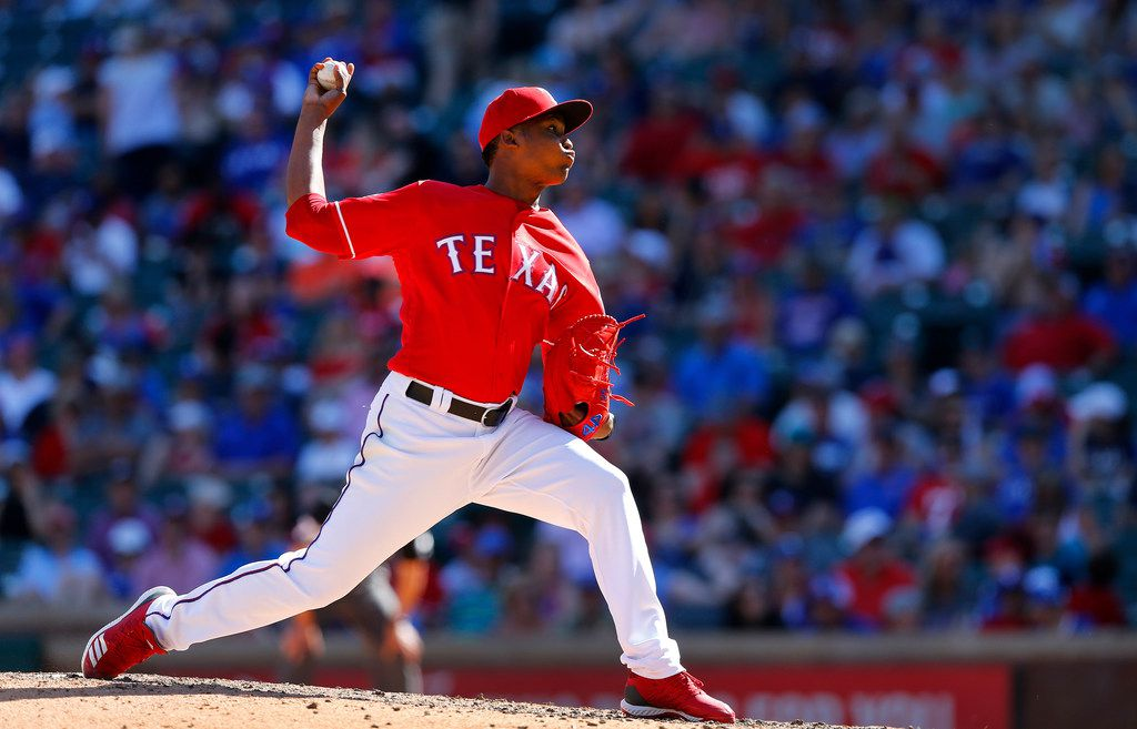 Texas Rangers relief pitcher Jose Leclerc (25) throws against the Houston Astros in the ninth inning at Globe Life Park in Arlington, Texas, April 21, 2019. (Tom Fox/The Dallas Morning News)